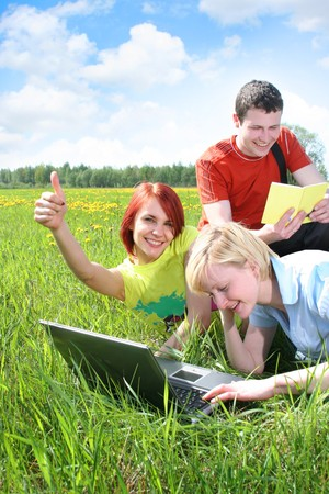 group of friends relaxing outdoors Stock Photo
