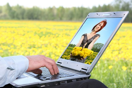 laptop with picture of beautiful girl on desctop photo