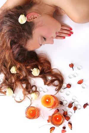 beautiful long-haired girl relaxing in spa salon photo