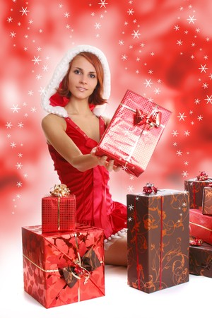 sexy young Santa-girl with presents Stock Photo - 4022702