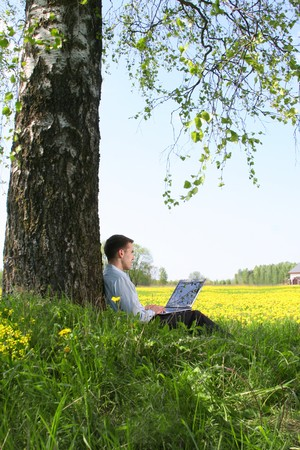 young guy is working outdoors
