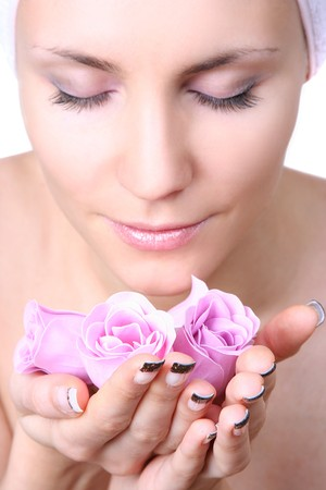 beautiful young woman with soap-flowers (soap in focus) Stock Photo