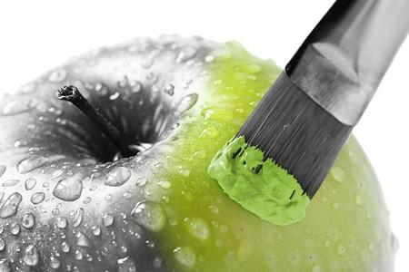 het schilderen van de groene appel Stockfoto