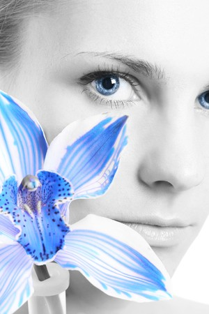 young girl with blue flower Stock Photo