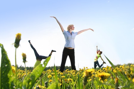happy girls jumping outdoors Stock Photo