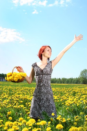 beautiful redhead girl with basket of dandelions Stock Photo - 4080794