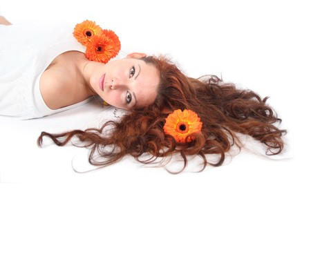 beautiful young girl with flowers in her hair