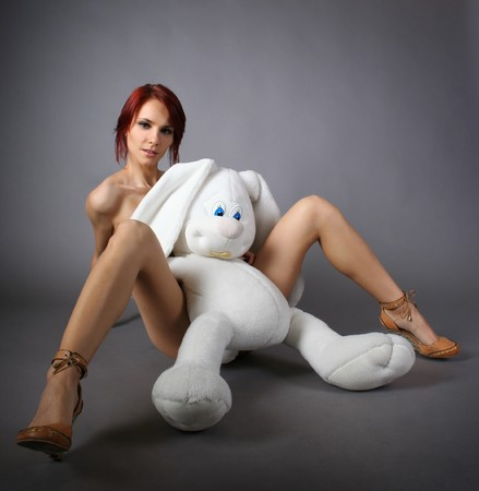 sexy young girl with white bunny Stock Photo