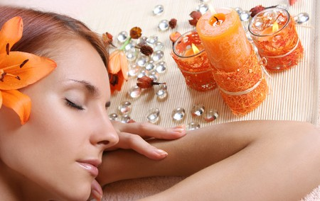 beautiful girl relaxing in spa salon Stock Photo
