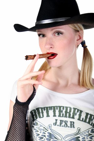portrait of sexy cowgirl with cigar on white background photo