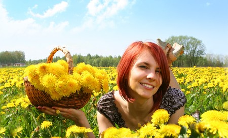 beautiful redhead girl in dandelion field Stock Photo - 4099835