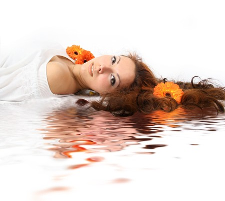 beautiful young girl with flowers is relaxing photo