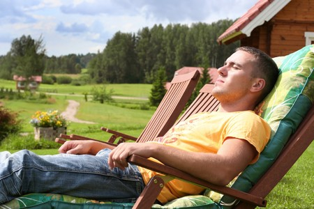 young man relaxing in country photo