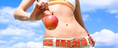 slim girl is holding red apple photo