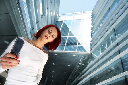 redhead girl with cellular Stock Photo - 4143812