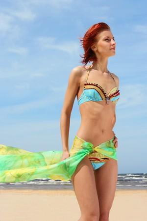 beautiful girl on the beach photo