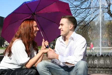 young couple under umbrella photo