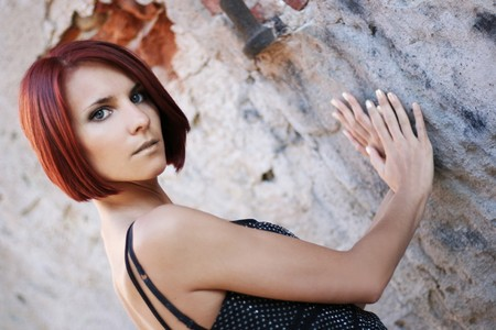 sexy young girl near old wall Stock Photo