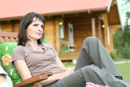 cute young girl relaxing in summer cottage  photo