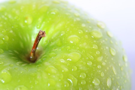 green apple with drops of water on it