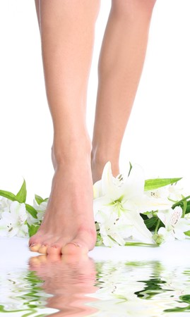 Beautiful legs with a lily flower Stock Photo