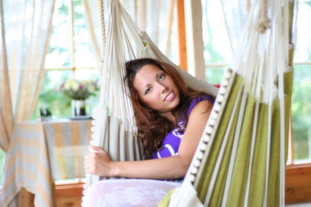 beautiful long-haired girl relaxing in hammock photo