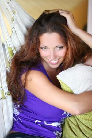 beautiful long-haired girl relaxing in hammock photo