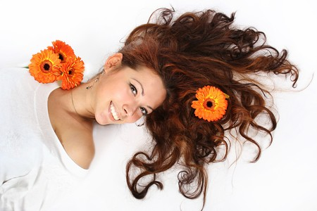 beautiful young girl with orange flowers in her hair Stock Photo
