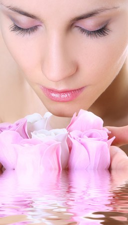 beautiful young woman with soap-flowers photo