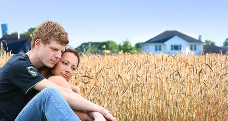 young couple near the house photo
