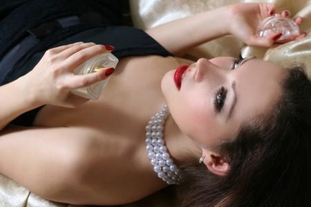 sexy beautiful woman smelling perfumes Stock Photo