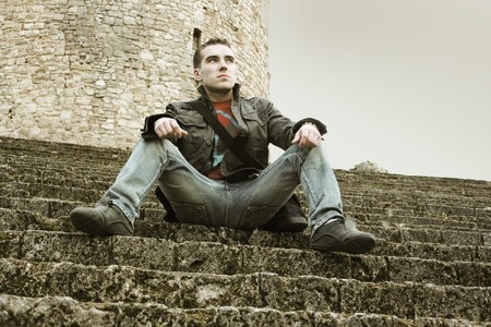 young guy sitting on stairs Stock Photo - 4413341
