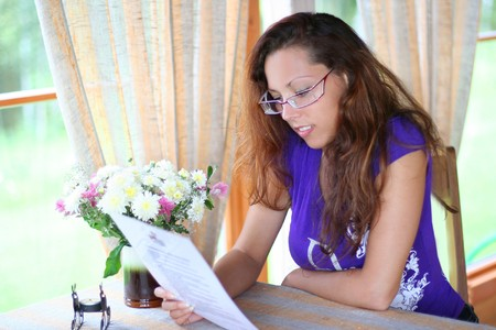 fare: beautiful young girl reading menu in coffee-house