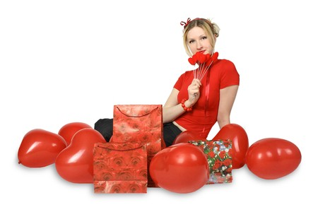 beautiful blond girl with red hearts and gift boxes photo