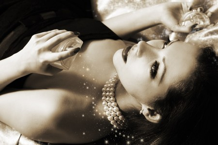 sexy beautiful woman with perfumes (colored sepia)