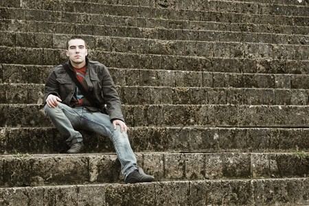 young guy sitting on stairs Stock Photo - 4538751