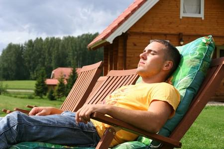 cute young guy relaxing outdoors photo
