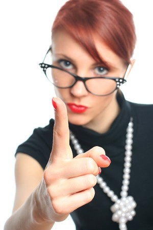 strict young retro-styled teacher (focus on hand) photo
