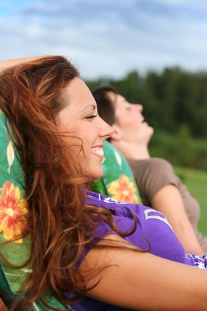 two young girls relaxing outdoors photo