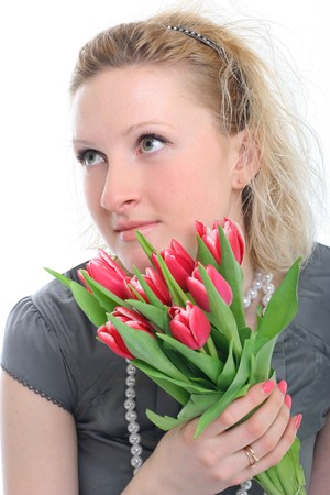 beautiful young woman with pink tulips photo