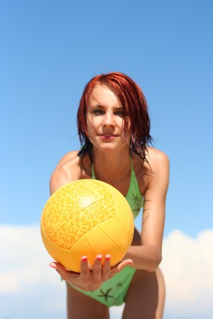young girl playing wirh ball on the beach (ball in focus) Stock Photo - 4567501