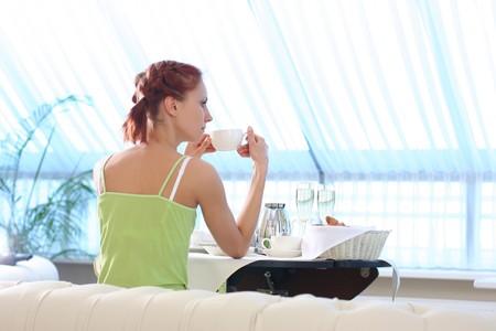 cute young woman having breakfast  photo