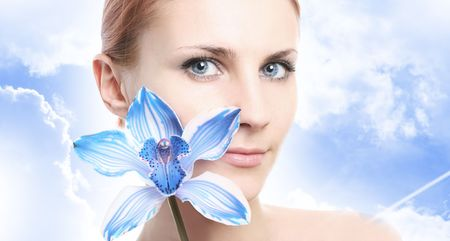 young girl with blue orchid photo
