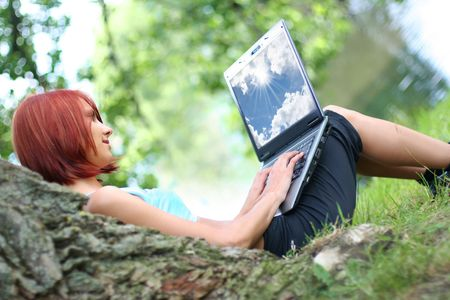 cute young girl with laptop outdoors Stock Photo - 4793878