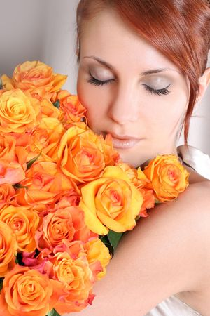 beautiful young woman with bunch of roses photo