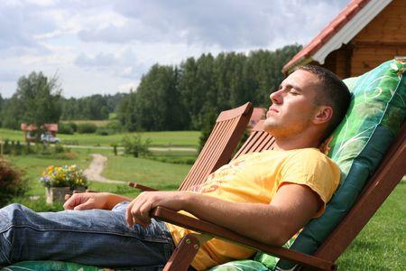 young man relaxing outdoors photo