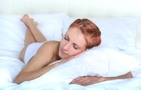 beautiful young woman relaxing in bed Stock Photo - 4913909