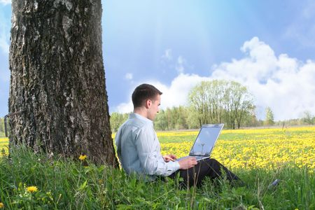young guy is working outdoors photo