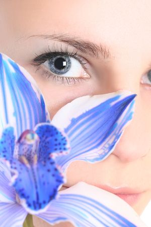 young girl with blue orchid Stock Photo - 4963829