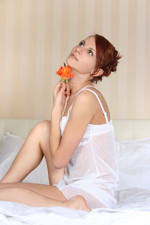 beautiful young woman relaxing in bed Stock Photo - 4963837